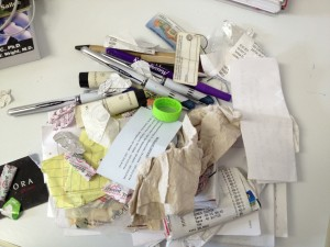 Pens, gum wrappers, grocery lists, receipts, a crumpled up napkin, and who knows what else.