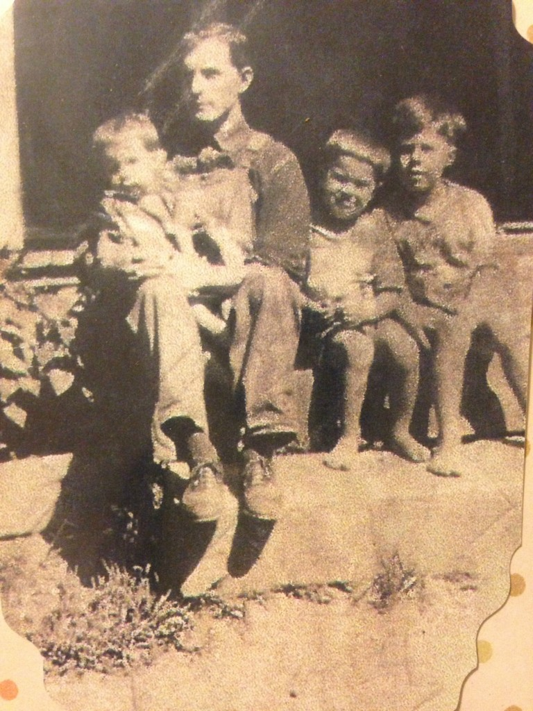 My great-grandfather Taylor with three of his sons. Neil is the middle boy, to Taylor's right.