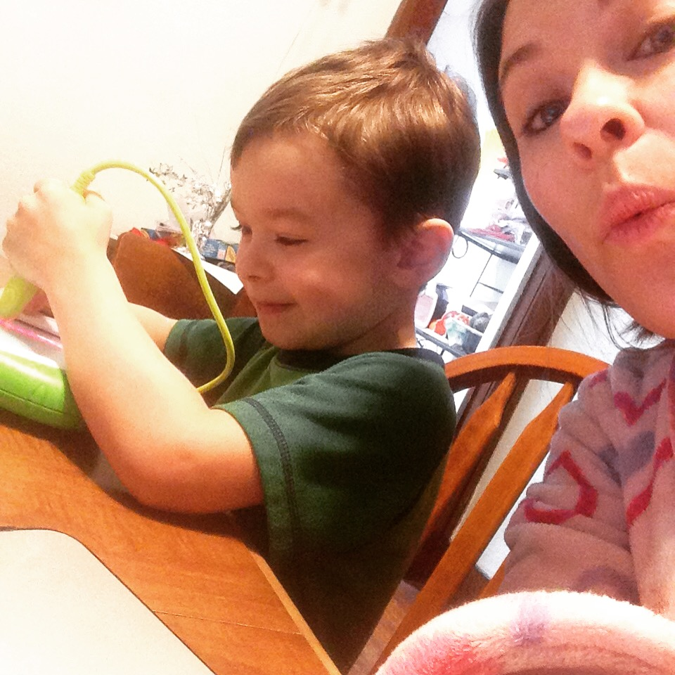 Jonah and me working hard - me w/ my laptop and him with his Leap Frog writing toy which he ADORES.